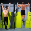 Stock Photo: Crossfit toes to bar men pull-ups 2 bars workout