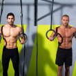 Crossfit dip ring two men workout at gym — Stock Photo #18030375