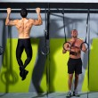 Stock Photo: Crossfit dip ring and toes to bar man pull-ups men