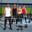 Gym group with weight lifting bar crossfit workout - Stock Photo