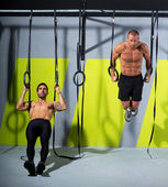 Crossfit dip ring two men workout at gym dipping — Stock Photo