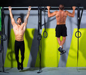 Crossfit toes to bar men pull-ups 2 bars workout — Stock Photo