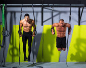 Crossfit dip ring two men workout at gym — Stock Photo