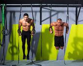 Crossfit dip ring two men workout at gym — Stock Photo