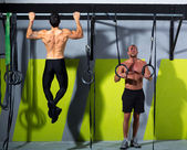Crossfit dip ring and toes to bar man pull-ups men — Stock Photo