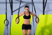 Crossfit dip ring woman workout at gym dipping — Stock Photo