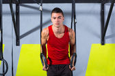 Crossfit dip ring young man workout at gym dipping — Stock Photo