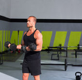 Gym man with dumbbells exercise crossfit — Zdjęcie stockowe