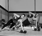 Gym man and woman push-up strength pushup — Stock fotografie
