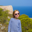 Child kid girl in mediterranean sea with sailor stripes - Foto Stock