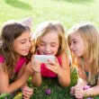 Children friend girls playing internet with smartphone — Stock Photo #18419057