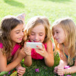 Stock Photo: Children friend girls playing internet with smartphone