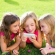 Children friend girls playing internet with smartphone — Stock Photo