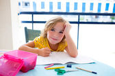 Child student kid girl bored with homework on desk — Stock Photo