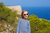 Child kid girl in mediterranean sea with sailor stripes — Stock Photo