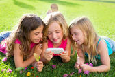 Children friend girls playing internet with smartphone — Stock Photo