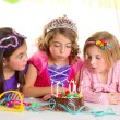 Children happy girls blowing birthday party cake — Stock Photo #18421933