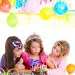 Children happy girls blowing birthday party cake — Stock Photo #18422189