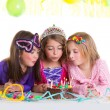 Children happy girls blowing birthday party cake — Stock Photo #18422409