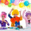 Children happy birthday party with clown wigs — Stock Photo #18422441