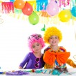 Children happy birthday party with clown wigs — Stock Photo #18422467