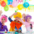 Children happy birthday party with clown wigs — Stock Photo #18422521