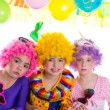 Children happy birthday party with clown wigs — Stock Photo