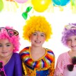 Children happy birthday party with clown wigs - Stock Photo