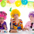 Children happy birthday party eating chocolate cake — Stock Photo #18422755