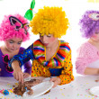 Stock Photo: Children happy birthday party eating chocolate cake