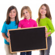 Children girls group holding blank blackboard copy space — Foto Stock