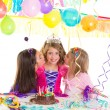 Children girls group in birthday party greetings with a kiss — Stock Photo