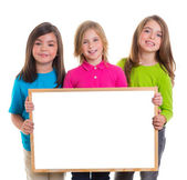 Children girls group holding blank white board copy space — Stock Photo