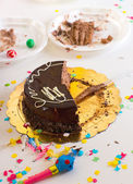 Chidren end of party with half chocolate cake slices — Stock Photo