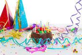 Children birthday party with chocolate cake — Stock Photo