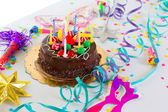 Children birthday party with chocolate cake — Stock Photo