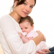 Baby girl relaxed with pacifier hug in mother arms — Stock Photo