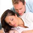 Baby girl mother and father family happy lying together — Stock Photo