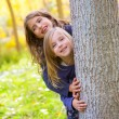 Autumn sister kid girls playing in forest trunk outdoor — 图库照片