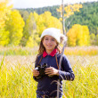 Stock Photo: Explorer binocuar kid girl in yellow autumn nature
