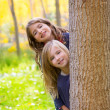 Stock Photo: Autumn sister kid girls playing in forest trunk outdoor