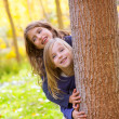 Autumn sister kid girls playing in forest trunk outdoor — Stock Photo #19533057