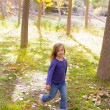 Autumn kid girl running poplar tree forest motion blur — Stock Photo #19533097
