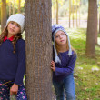 Autumn sister kid girls playing in forest trunk outdoor — Stock Photo #19533133