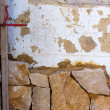Masonry stone wall construcion process traditional - Stock Photo