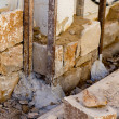 Stock Photo: Masonry stone wall construcion process traditional