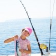 Child little girl fishing in boat holding little tunny fish catc — Stock Photo #19535537