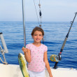 Child girl fishing in boat with mahi mahi dorado fish catch — Stock Photo