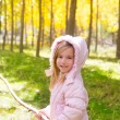 Explorer girl with stick in poplar yellow autumn forest — Stock Photo