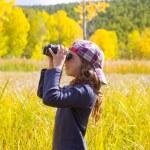 Explorer binocuar kid girl in yellow autumn nature — Stock Photo